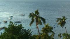 Traditional Filipino outriggers outside Sabang on Oriental Mindoro Philippines Stock Footage