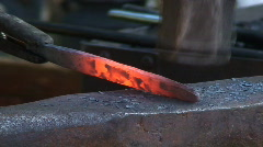 Blacksmith working on metal during medieval week in Visby Sweden - stock footage