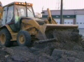 Backhoe Loader Pushing Pavement Footage