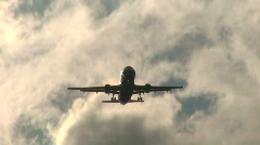 Landing plane at sunset 5 Stock Footage
