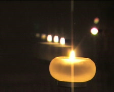 Candle and its reflections flaming at night III - stock footage