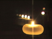 Stock Video Footage of Candle and its reflections flaming at night III
