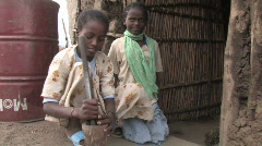 Ethiopia: Young girl pounds Coffee - stock footage