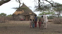 Ethiopia: Family walks toward typical home - stock footage