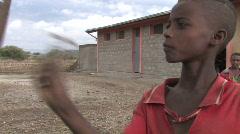 Stock Video Etiopian: Poika soi koulun kello Arkistovideo