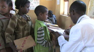 Stock Video Footage of Ethiopia: Students come to teacher