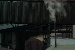 Steam pipe in factory Stock Footage