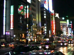 Downtown Tokyo at night Stock Footage