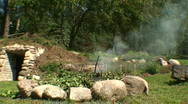 Stock Video Footage of Outdoors fireplace in countryside 2