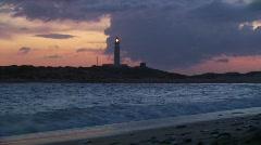 Lighthouse on headland Stock Footage