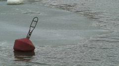 Red buoy near trash-ice Stock Footage