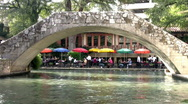 Stock Video Footage of San Antonio Riverwalk foot bridge umbrellas Texas HD