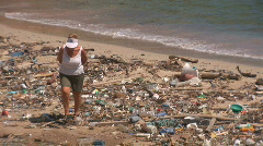 Beach with pollution - woman walking Stock Footage