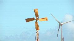 Old windmill & new wind turbine Stock Footage