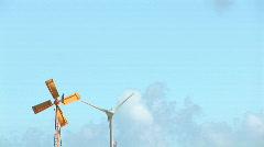 Old windmill & new wind turbine - left side - stock footage