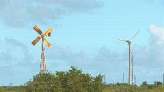 Old windmill & new wind turbine - wide Stock Footage