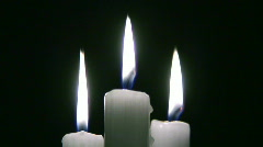 Three candles Stock Footage