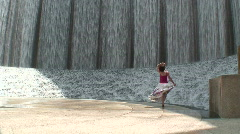 Woman at the fountain 1 Stock Footage