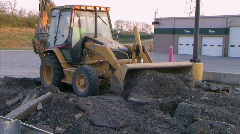 Backhoe Loader Pushing Pavement Stock Footage