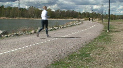 Jogging in summer near bay 2 Stock Footage