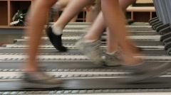 Feet on treadmill Stock Footage