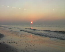 Sunset at the North Sea coast in the Netherlands Stock Footage