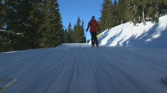 Two skiers following camera part II Stock Footage