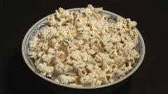 Woman eating popcorn Stock Footage