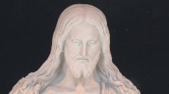 Christ face pan to right hand 24 fps HD Stock Footage