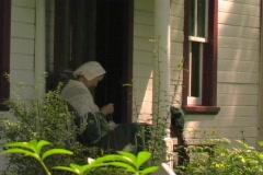 SEWING PIONEER LADY - stock footage