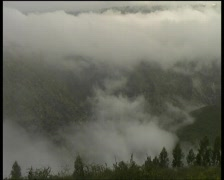 Morning mist rising from an Andean valley - stock footage