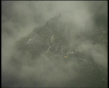 Misty Andean hillside with distant road and traffic - stock footage