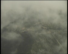 Misty Andean hillside with distant road and traffic Stock Footage