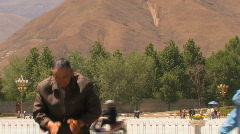 An old man praying outside Potala Stock Footage