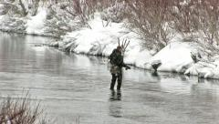 Fly fisherman river winter storm HD Stock Footage