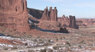 Stock Video Footage of Arches NP car drive by Three Gossip Rock HD