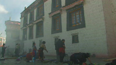 People praying outside Jokhang temple in Lhasa, Tibet Stock Footage