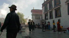 Lots of people praying outside Jokhang temple in Lhasa, Tibet Stock Footage