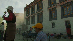 Many people praying outside Jokhang temple in Lhasa, Tibet Stock Footage
