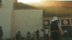 Tibetan people praying outside Jokhang temple in Lhasa, Tibet Stock Footage