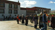 Stock Video Footage of Tibetan people walking and praying outside Jokhang temple in Lhasa, Tibet