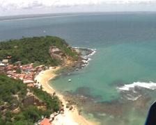 Microlight flight over an island (1) Stock Footage