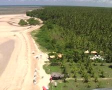 Microlight flight over an island (3) - landing Stock Footage