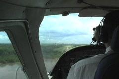 Landing on dirt runway in Africa Stock Footage