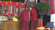 Stock Video Footage of 2 Buddhist Monks talking inside Jokhang Temple Tibet