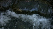 Stock Video Footage of bubbling water over rocks