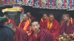 Buddhist monks performing ceremony inside Jokhang Temple Tibet Stock Footage