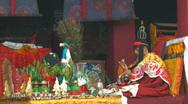 Buddhist Monk praying inside Jokhang Temple, Tibet Stock Footage