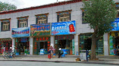 Outside a shop in Lhasa, Tibet Stock Footage