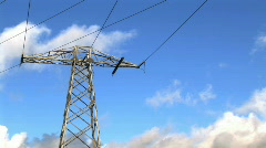 Clouds passing by Electicity Pylon Stock Footage